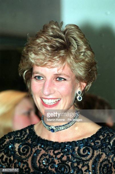 The Princess of Wales smiles as she talks with guests and artistes in the Cardiff International Arena before a 'Concert Of Hope' raising money for...