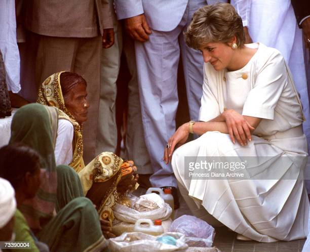 The Princess of Wales talking to a local woman during a visit to Hyderabad India February 1992 Diana is wearing a Catherine Walker outfit