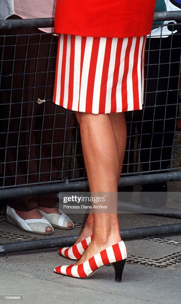 The Princess of Wales visits Lambeth in south London, May 1991. She is wearing a red and white striped skirt with matching shoes.