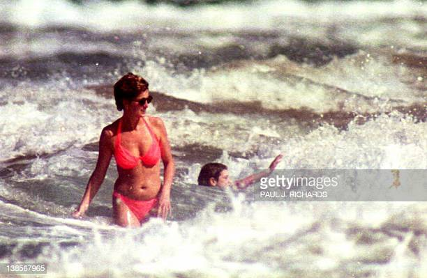 The Princess of Wales walks through the surf while at Indian Castle Beach 02 January 1993 during her Nevis West Indies vacation with her sonsThe boys...