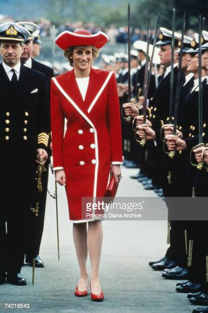 The Princess of Wales wears a red Catherine Walker dress and Philip Somerville hat to the passing out parade at Dartmouth Royal Naval College Devon...