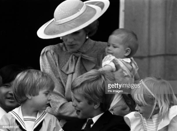 The Princess of Wales with baby Prince Harry Prince William and Peter Phillips on the balcony of Buckingham Palace London during the Trooping of the...