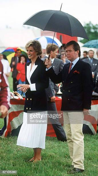The Princess Of Wales With Her Bodyguard Ken Wharfe Ken Wharfe Is Holding An Umbrella To Protect Princess Diana From The Rain