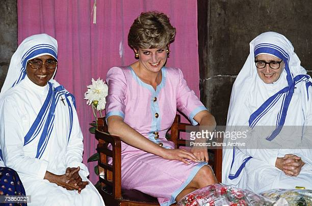 The Princess of Wales with two nuns during a visit to Mother Theresa's headquarters in Calcutta India 15th February 1992 Diana is wearing a dress by...
