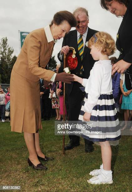 The Princess Royal is presented with a single white rose by five year old Rowan Krier during a visit to the Great Yorkshire Show Harrogate
