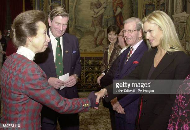 The Princess Royal meets TV gameshow hostess Lia Kristenson and game show host Bob Holness at the Not Forgotten Association Christmas party for...