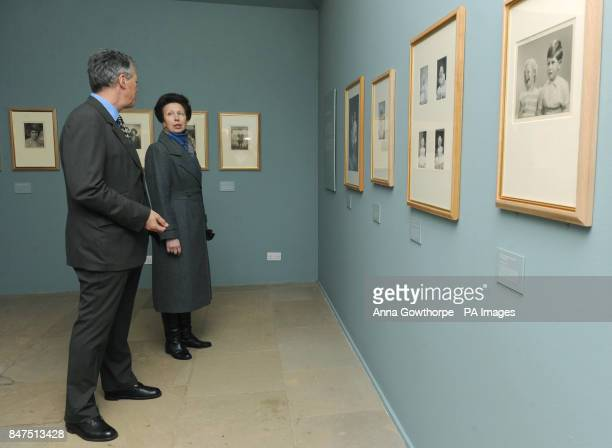 The Princess Royal speaks with David Lascelles Earl of Harewood as they view an exhibition of royal photographs taken by royal photographer Marcus...