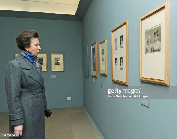 The Princess Royal views an exhibition of royal photographs taken by royal photographer Marcus Adams on display at Harewood House Leeds