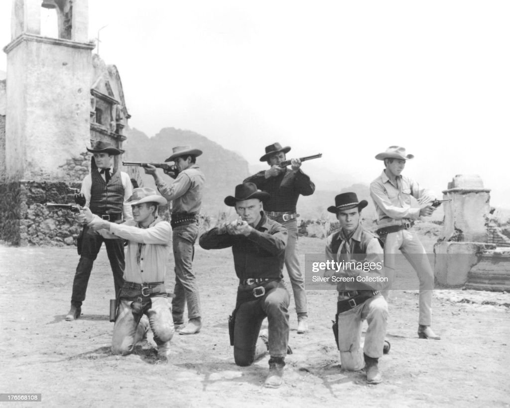 The principle cast in a publicity still for 'The Magnificent Seven', directed by John Sturges, 1960. Left to right: <a gi-track='captionPersonalityLinkClicked' href=/galleries/search?phrase=Robert+Vaughn&family=editorial&specificpeople=242794 ng-click='$event.stopPropagation()'>Robert Vaughn</a> as Lee, Steve McQueen (1930 - 1980) as Vin Tanner, <a gi-track='captionPersonalityLinkClicked' href=/galleries/search?phrase=Charles+Bronson&family=editorial&specificpeople=220998 ng-click='$event.stopPropagation()'>Charles Bronson</a> (1921 - 2003) as Bernardo O'Reilly, <a gi-track='captionPersonalityLinkClicked' href=/galleries/search?phrase=Yul+Brynner&family=editorial&specificpeople=204712 ng-click='$event.stopPropagation()'>Yul Brynner</a> (1920 - 1985) as Chris Adams, Brad Dexter (1917 - 2002) as Harry Luck, <a gi-track='captionPersonalityLinkClicked' href=/galleries/search?phrase=Horst+Buchholz&family=editorial&specificpeople=1053802 ng-click='$event.stopPropagation()'>Horst Buchholz</a> (1933 - 2003) as Chico, and <a gi-track='captionPersonalityLinkClicked' href=/galleries/search?phrase=James+Coburn&family=editorial&specificpeople=221456 ng-click='$event.stopPropagation()'>James Coburn</a> (1928 - 2002) as Britt.