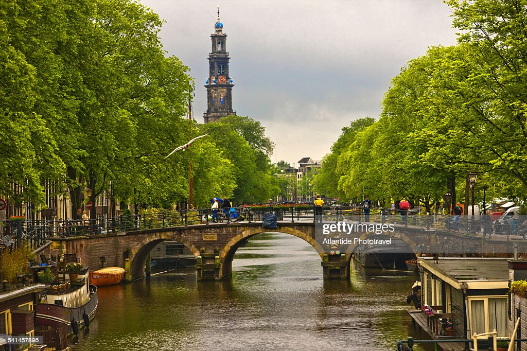 The Prinsengracht canal and the bell-tower of Westerkerk (western church)