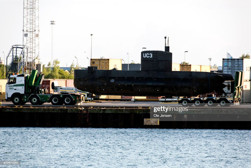 The privately owned submarine, Nautilus, which is the suspected crime scene for the assumed murder on Swedish journalist Kim Wall, is carried out of Copenhagen harbor on a truck for further forensic police investigation taking place near the harbor on August 13, 2017 in Copenhagen, Denmark. The submarine sailed out of Copenhagen harbor Thursday evening with owner Peter Madsen and Kim Wall onboard. Later the submarine sank in 8 meters water. Peter Madsen was safely rescued but the Swedish journalist was missing and Madsen was subsequently arrested by the police and charged for murder. Madsen claimed that the woman was put ashore before the submarine sank. Madsen appeared for a preliminary examination at the Copenhagen Court Saturday afternoon. Police are now to investigate the submarine, which is built by Madsen himself. The Swedish journalist is still being searched for by the police. Her identity was released Saturday by her family to Danish broadcaster TV2.