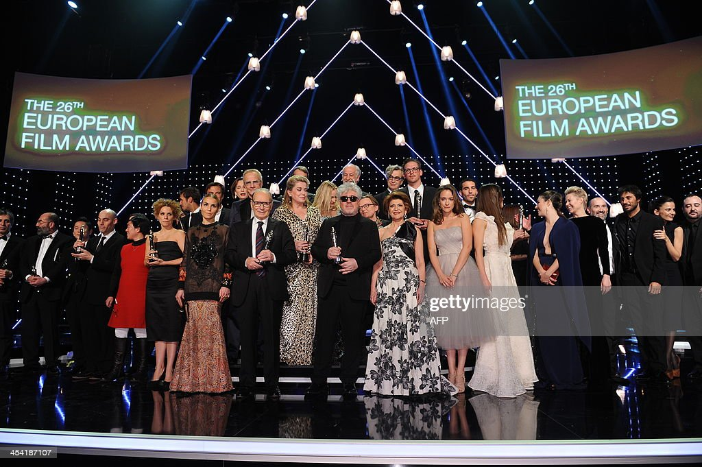 The prize winners pose for a photo with their awards on stage at the 26th European Film Awards ceremony on December 7, 2013 in Berlin. Every year, the various activities of the European Film Academy culminate in the ceremony of the European Film Awards. In a total of 21 categories, among them European Film, European Director, European Actress and European Actor, the European Film Awards annually honour the greatest achievements in European cinema.