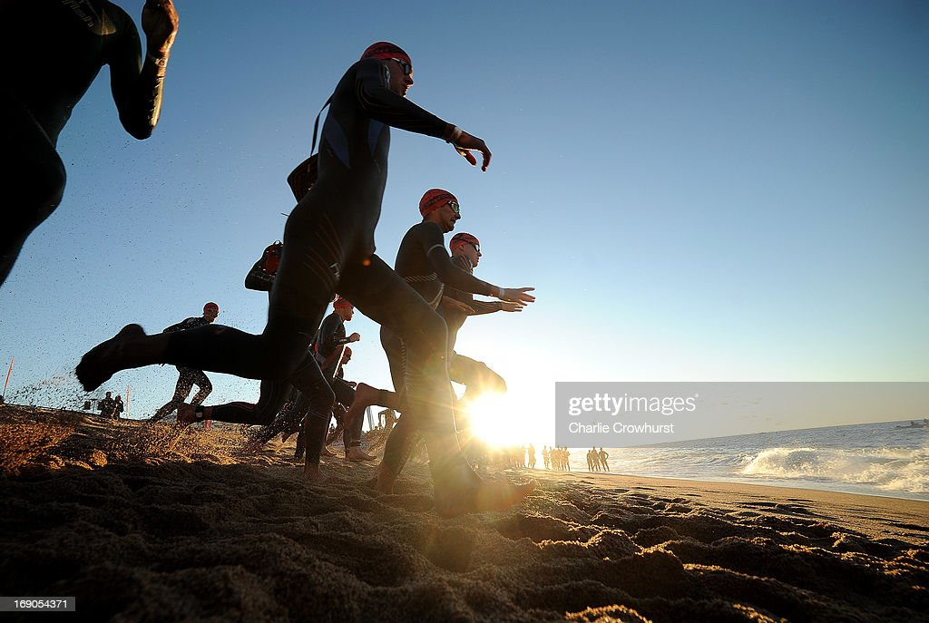 The pro men race down to the sea to begin the swim during the Challenge Family Triathlon Barcelona on May 19, 2013 in Barcelona, Spain.