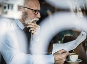 The problem has arisen. Business man reading a document. Close up.