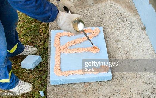 The process of applying construction foam : Stock Photo