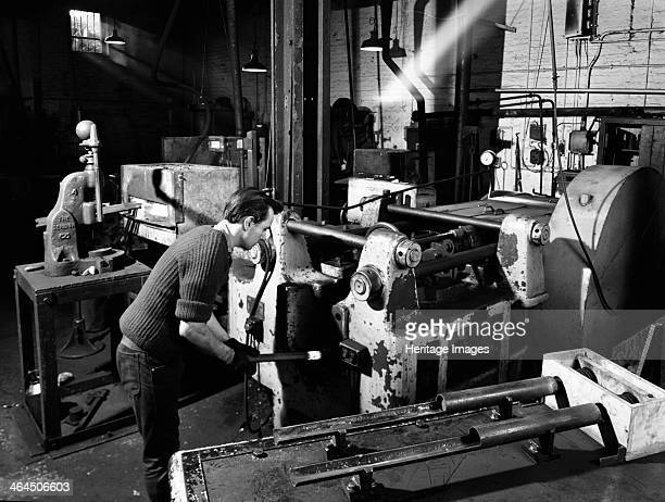The process of forging heads at the Edgar Allen Steel Foundry Sheffield South Yorkshire 1962 The forge presses metal between two dies that contain a...