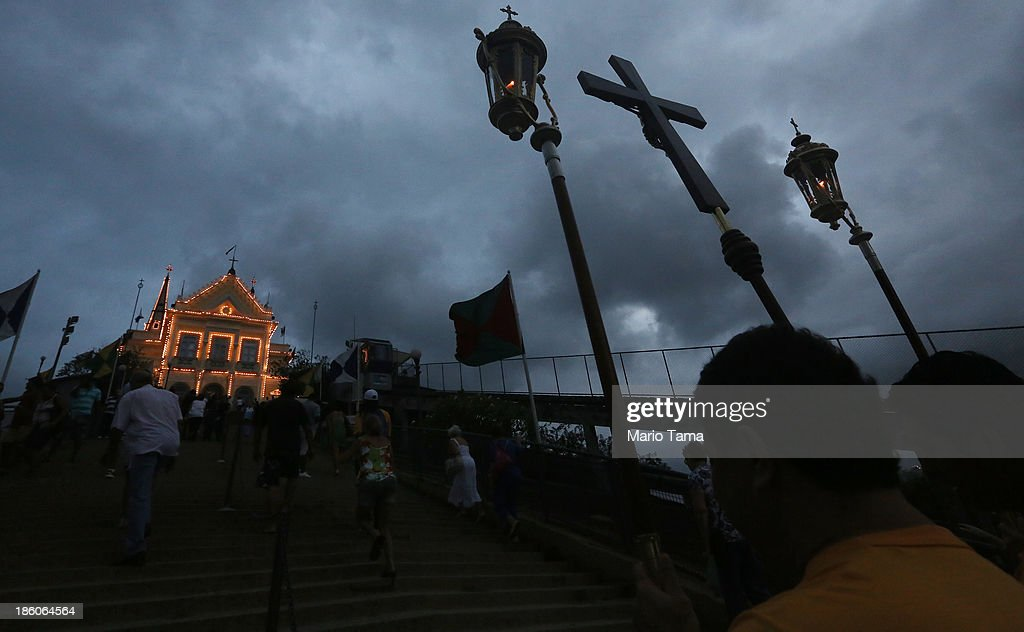 The procession marches to the Nossa Senhora da Penha Church on the final day of the annual October feast of the patron saint marking the 378th anniversary of the church on October 27, 2013 in Rio de Janeiro, Brazil. Pilgrims often climb the entire 382 steps that lead to the church, originally constructed in 1635, which is perched on a rocky hill. Brazil holds more Catholics than any other country.