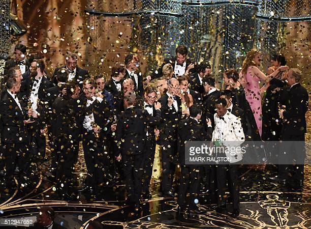 The production team and cast of Spotlight celebrate the award for Best Picture on stage at the 88th Oscars on February 28 2016 in Hollywood...