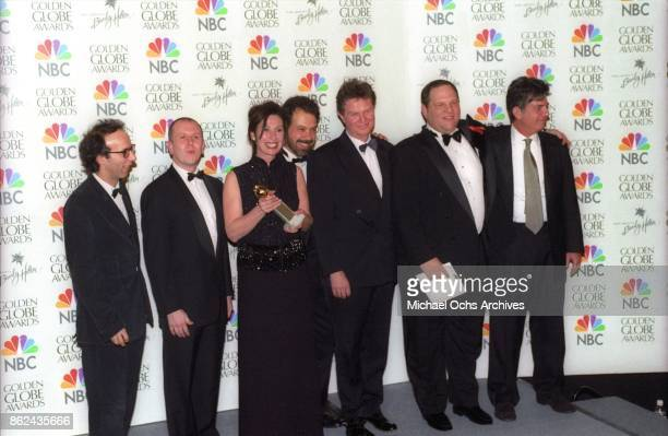 The production team for Shakespeare in Love pose backstage after receiving the award for Best Film Musical or Comedy on January 24 1999 at the...