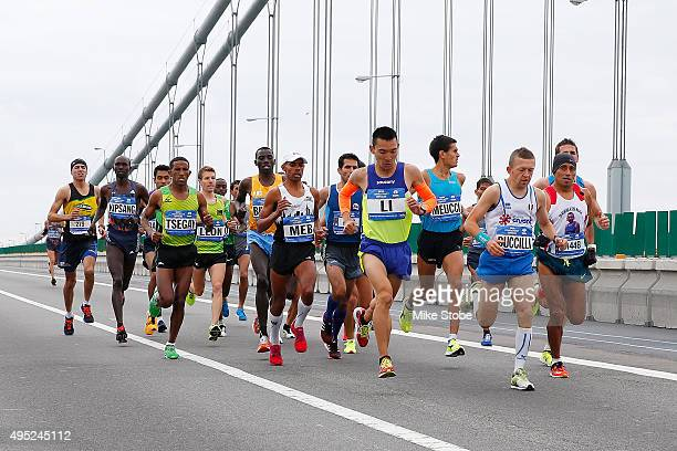 The Professional Mesn's division of runners cross the VerrazanoNarrows Bridge at the start of the TCS New York City Marathon on November 1 2015 in...