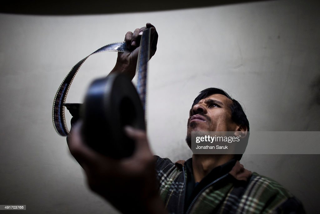 The projectionist at work at Ariana Cinema December 1, 2010 in Kabul, Afghanistan. Going to the movies, once banned under the Taliban, has become a popular form of entertainment in Kabul, but women and children rarely take part.