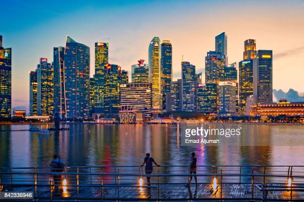 The promenade at Marina Bay Sands with Singapore cityscape in the background. Singapore - August 21, 2017