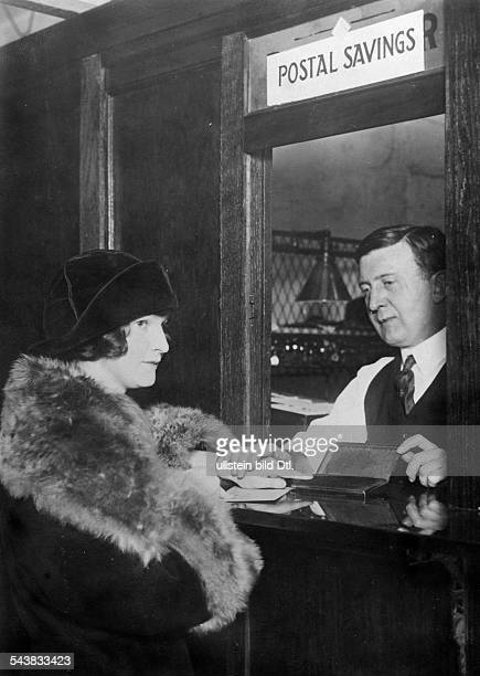 USA The proof of account holders at the post office savings bank a woman giving her fingerprint at the counter of a post office ca 1922 Photographer...