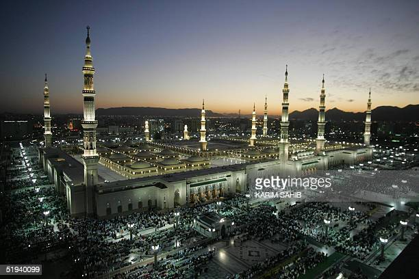 The Prophet Mohammed Mosque is lit during the sunset prayers in the holy Saudi city of Medina 11 January 2005 Saudi Arabia began receiving Muslim...