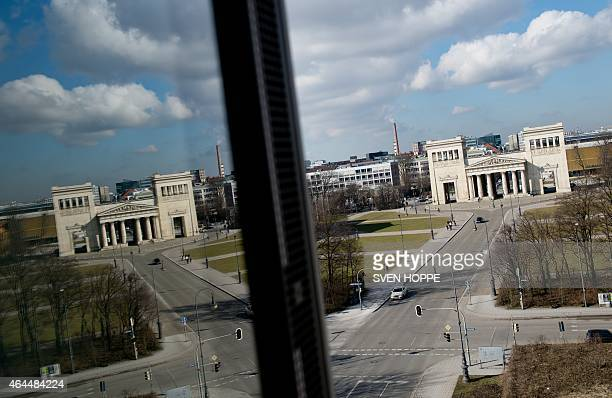 The Propylaea city gate at Koenigsplatz square is reflected in a window of the new building of the Documentation Centre for the History of National...