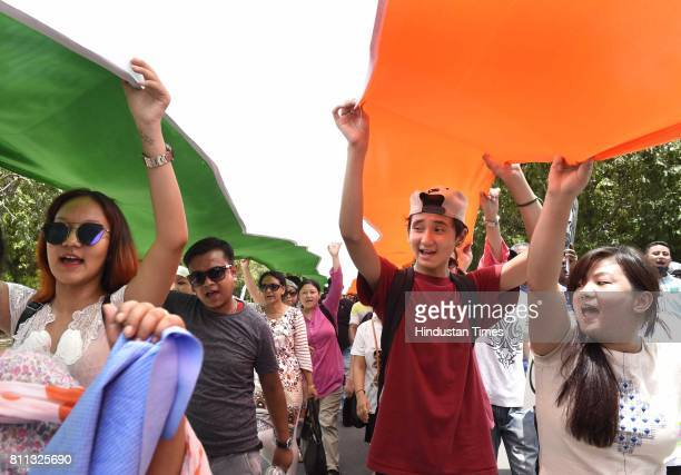 The protesters march from Rajghat to Jantar Mantar carrying the flag depicting 110 years of their struggle for separate state and demanding the...