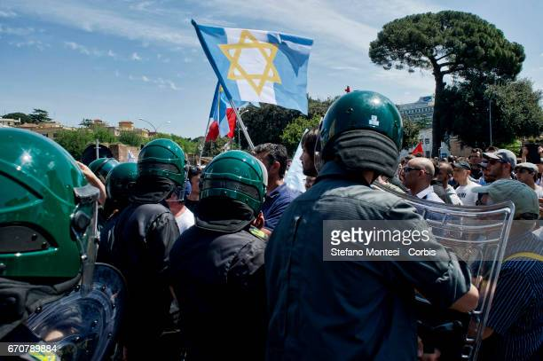 The protesters of the Jewish community of Rome with the flag of Israel blocked by police during the march for the Liberation of Nazifascism organised...