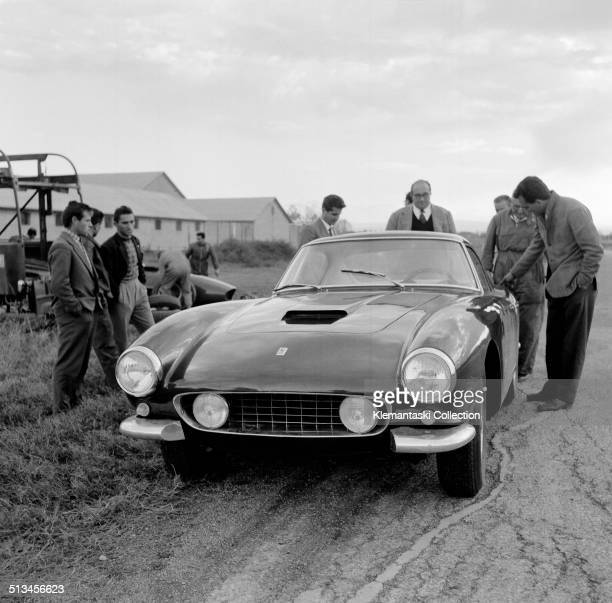 The prototype for the new 'Ferrari 250 GT Berlinetta SWB' on test at the Modena Aerautodromo with the Ferrari transporter in the background Watching...