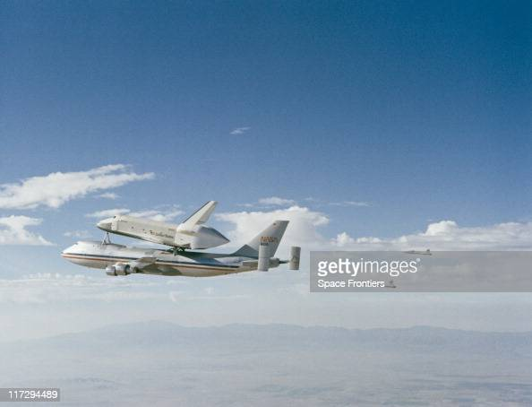 The prototype Space Shuttle Enterprise riding 'piggyback' on the Boeing 747 Shuttle Carrier Aircraft before the first free flight of the Shuttle...
