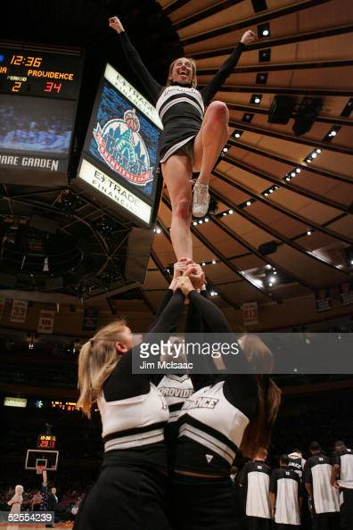 The Providence College Friars Cheerleaders perform during the Big East Men's Basketball Championship against the West Virginia University...