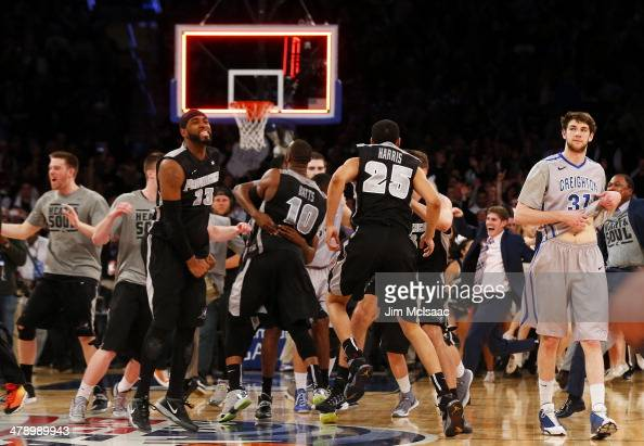 The Providence Friars celebrate their 65 to 58 win over the Creighton Bluejays in the Championship game of the 2014 Men's Big East Basketball...