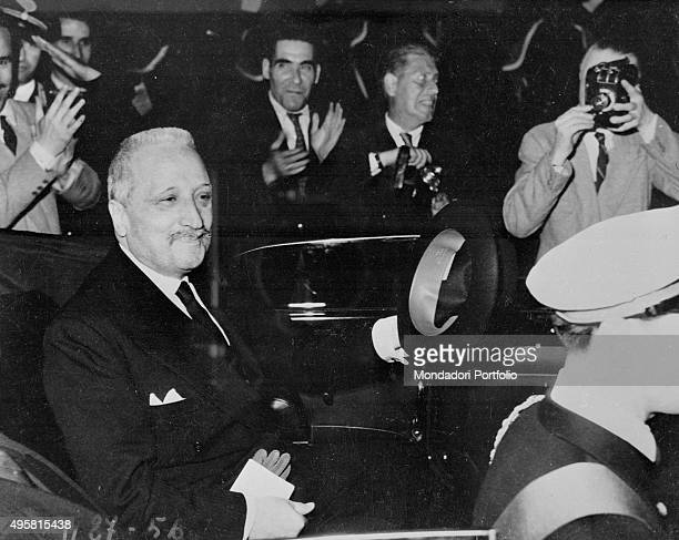 The provisional Head of State of Italy Enrico De Nicola on a car greeting the crowd arriving to Montecitorio on the occasion of the celebration of...