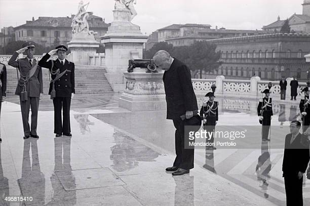 The provisional Head of State of Italy Enrico De Nicola visiting the Altar of the Fatherland bowing in front of the Tomb of the Unknown Soldier Rome...