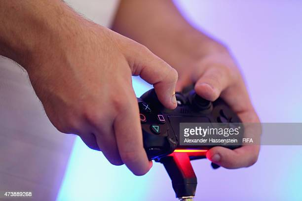 The PS4 wireless controller during the group stage of the finale for FIFA Interactive World Cup 2015 at Palais am Lenbachplatz on May 18 2015 in...