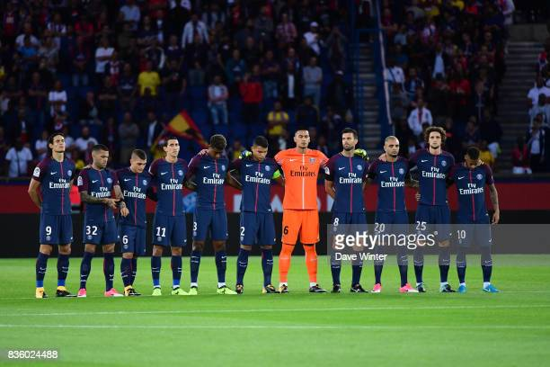 The PSG team stand for a minute of silence in honour of the victims of the Barcelona terrorist attack before the Ligue 1 match between Paris Saint...