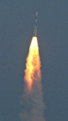 The PSLVC25 launch vehicle carrying the Mars Orbiter probe as its payload lifts off from the Satish Dhawan Space Centre in Sriharikota on November 5...