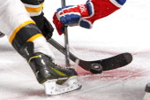 The puck bounces on the ice during a faceoff between the Montreal Canadiens and the Boston Bruins in Game Six of the Second Round of the 2014 NHL...