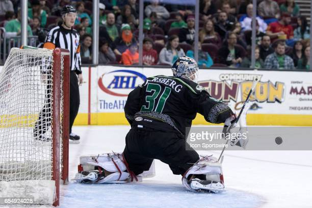 The puck deflects off the blocker of Cleveland Monsters G Anton Forsberg during the second period of the AHL hockey game between the Texas Stars and...