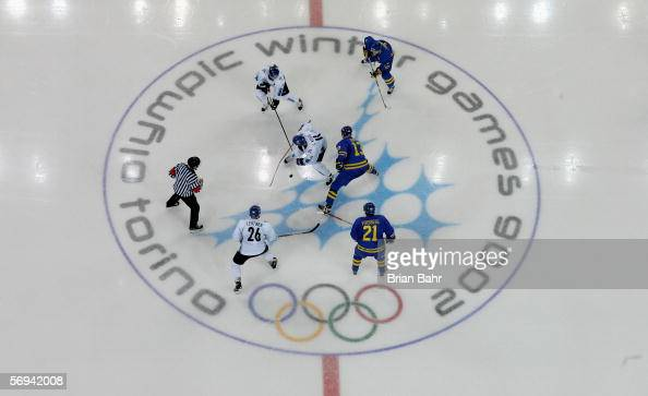The puck drops during the final of the men's ice hockey match between Finland and Sweden during Day 16 of the Turin 2006 Winter Olympic Games on...