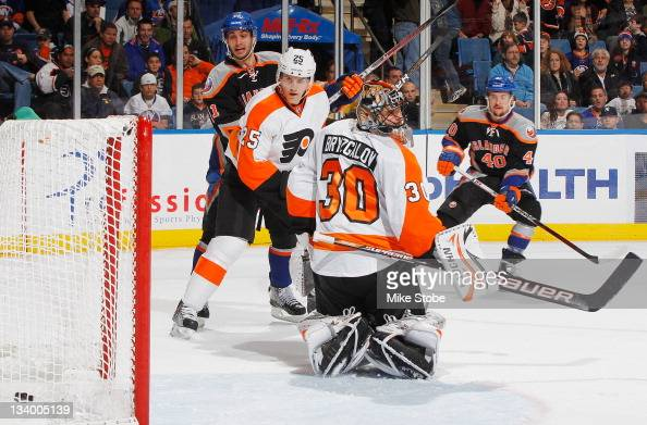 The puck flies into the net past Ilya Bryzgalov of the Philadelphia Flyers for a first period goal by Michael Grabner of the New York Islanders at...