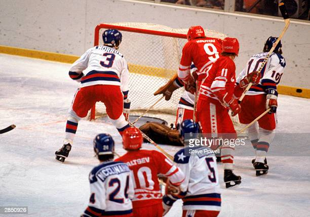 The puck flies past the United States goal during the Olympic hockey game against the Soviet Union on February 22 1980 in Lake Placid New York The...