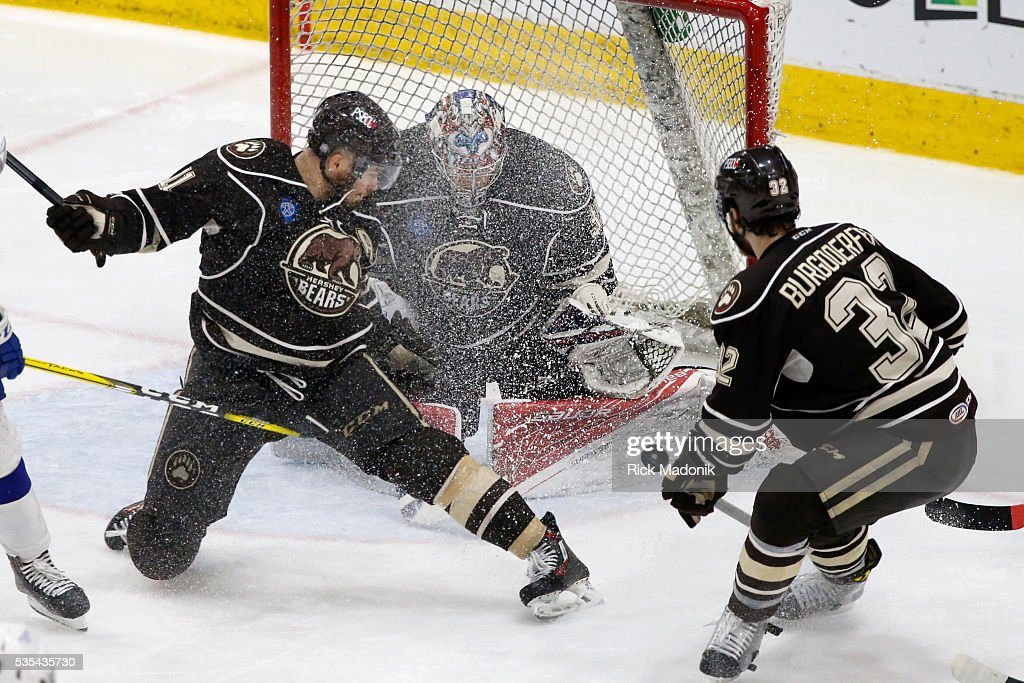 The puck floats by as Hershey Bears goalie Justin Peters (35) is hit with a snow shower. Toronto Marlies V Hersey Bears during 3rd period play of Game 5 of AHL playoff action at the Ricoh Coliseum. Marlins lose 3-2 and Hersey wins the series 4-1. Toronto Star/Rick Madonik