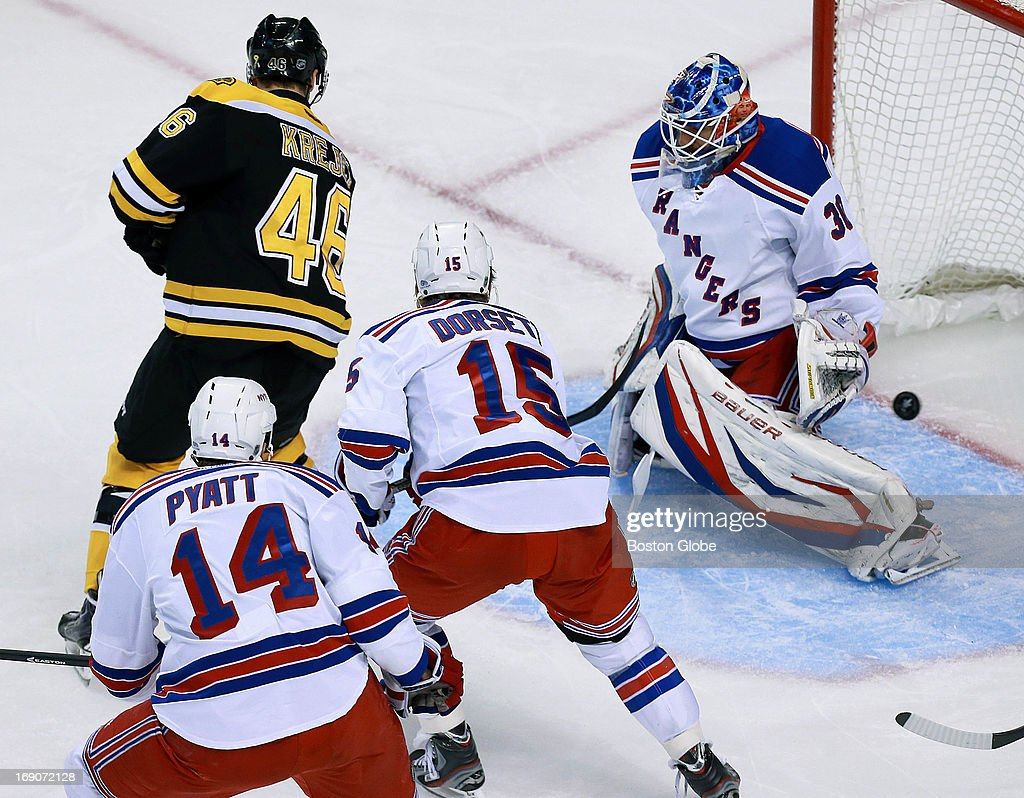 The puck gets by Rangers goalie Henrik Lundqvist in the first period, a goal scored by the Bruins Torey Krug, not pictured, that put Boston ahead 1-0. The Boston Bruins hosted the New York Rangers in Game Two of the Eastern Conference semifinals at the TD Garden.