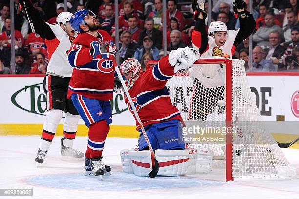 The puck gets past Carey Price of the Montreal Canadiens on a shot by Milan Michalek of the Ottawa Senators in Game One of the Eastern Conference...