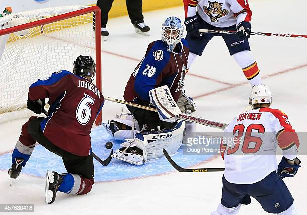 The puck gets past goalie Reto Berra of the Colorado Avalanche on the game winning goal by Brad Boyes of the Florida Panthers in overtime at Pepsi...