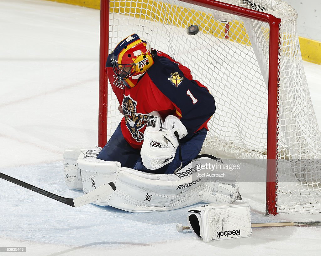 The puck goes by goaltender <a gi-track='captionPersonalityLinkClicked' href=/galleries/search?phrase=Roberto+Luongo&family=editorial&specificpeople=202638 ng-click='$event.stopPropagation()'>Roberto Luongo</a> #1 of the Florida Panthers after he lost his stick and glove in a collision in the goal crease with Jay McClement #11 (not pictured) the Toronto Maple Leafs at the BB&T Center on April 10, 2014 in Sunrise, Florida. The Panthers defeated the Maple Leafs 4-2.